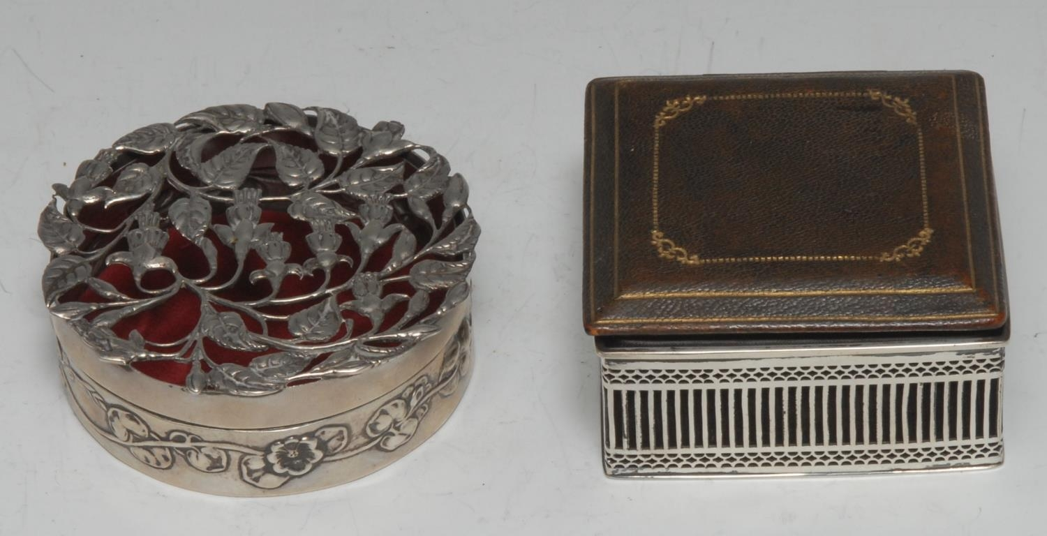 An Edwardian silver circular pot pourri, the push-fitting cover pierced and...