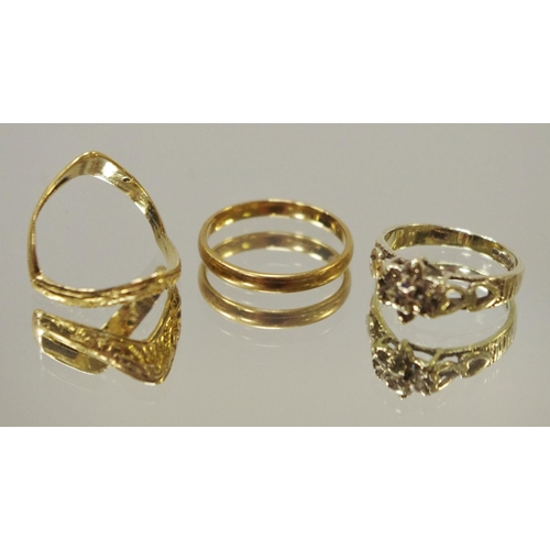 72 - A 9ct gold wedding band; a 9ct gold double wishbone ring; a 9ct white gold ring set with diamond chi...