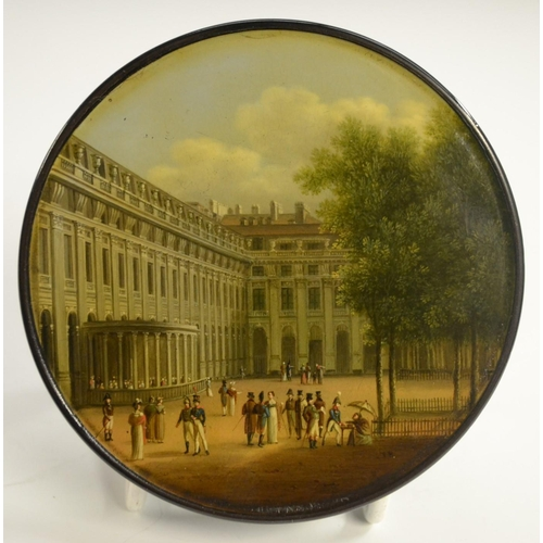 1153 - An early 19th century German Named-View papier-mâché circular table-top snuff box, by Stobwasser of ...