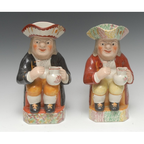 13 - A 19th century Staffordshire Toby jug, seated holding a jug of foaming ale, wearing a tricorn hat sp...