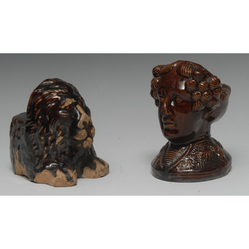 14 - A 19th century Staffordshire treacle glazed sash window supports, as a curly haired gentleman, 12.5c...