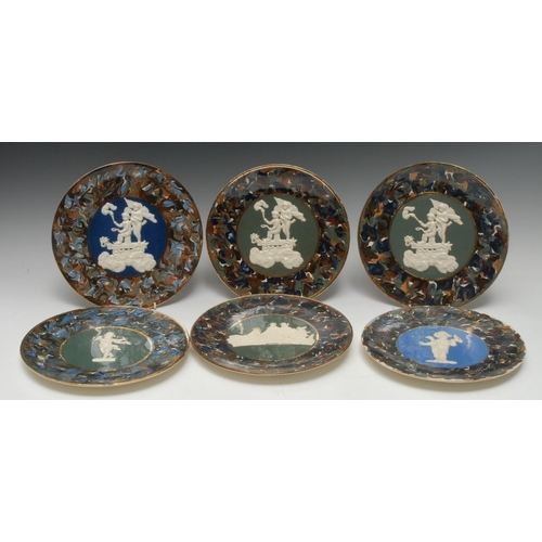 27 - A pair of Thomas Fradley circular plates, applied in white relief with cherubs on a cart, marbled bo...