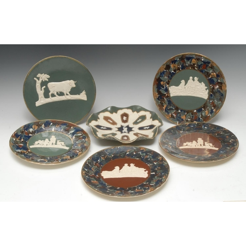 29 - A pair of Thomas Fradley circular plates, applied in white relief with hunter, attendant and hounds,...