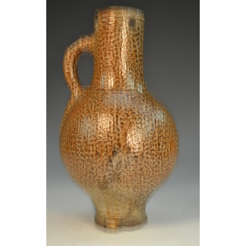 3 - A 16th/17th century tiger glaze stoneware bellarmine, loop handle, 22cm high, c.1580 - 1650...