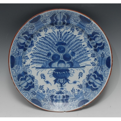 38 - An 18th century Dutch Delft circular Peacock dish, typically painted in underglaze blue, iron red li...