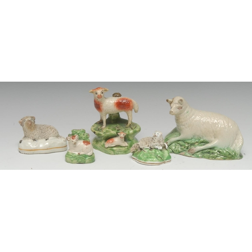 40 - An 18th century Staffordshire creamware recumbent sheep, leaf moulded green base, 14.5cm wide, c.179...