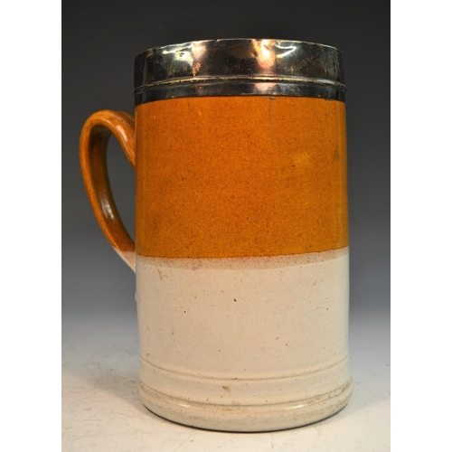 43 - An early 18th century silver-mounted London stoneware quart mug, quite plain, the collar rim monogra...
