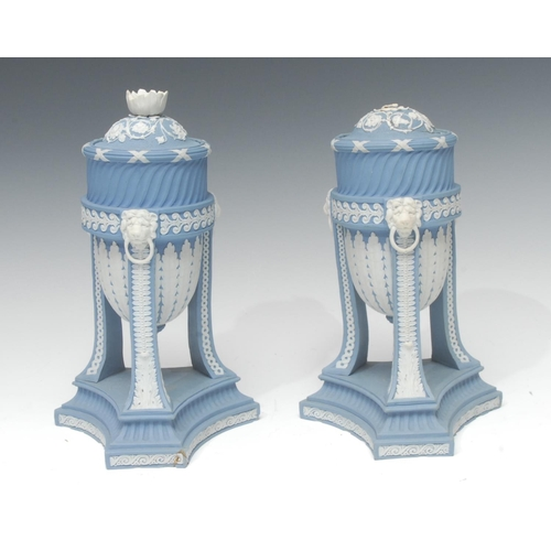 57 - A pair of Wedgwood blue jasper cassolettes, the ovoid bowls applied white relief with stiff leaves, ...