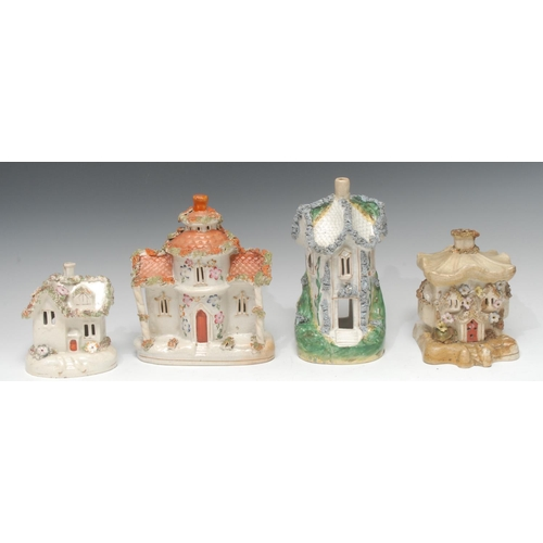 9 - A 19th century Staffordshire cottage, applied with shredded clay, 24cn high, c.1880;  others (4)...