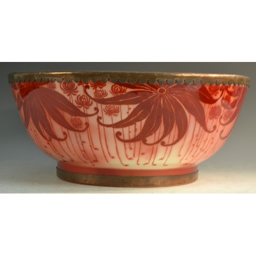 53 - A Bernard Moore red lustre punch bowl, decorated with large leaves on a red ground, metal rim, 40cm ...
