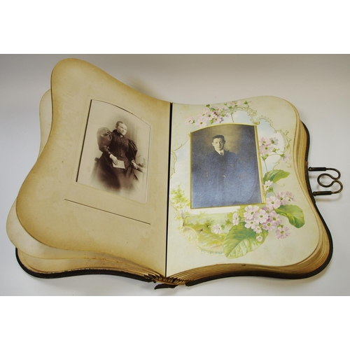 58 - An Art Nouveau photograph album each page with Victorian & Edwardian portraiture the cover embossed ...