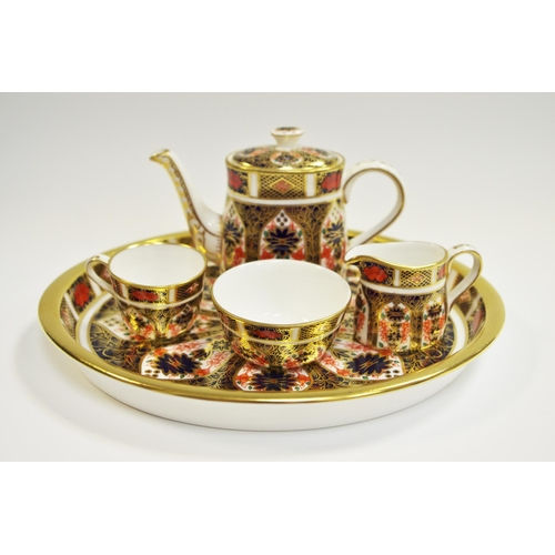 11 - An Royal Crown Derby 1128 Imari pattern miniature tea set on tray, teacup, teapot, sugar bowl and cr...