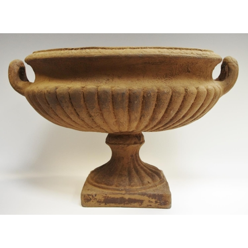 24 - Interior Design - a cast iron effect twin handled gadrooned oval urn...