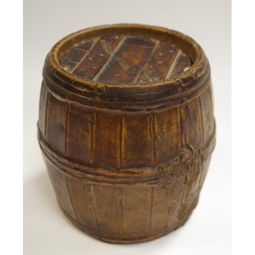 28 - A Bretby tobacco jar in the form of a barrel...