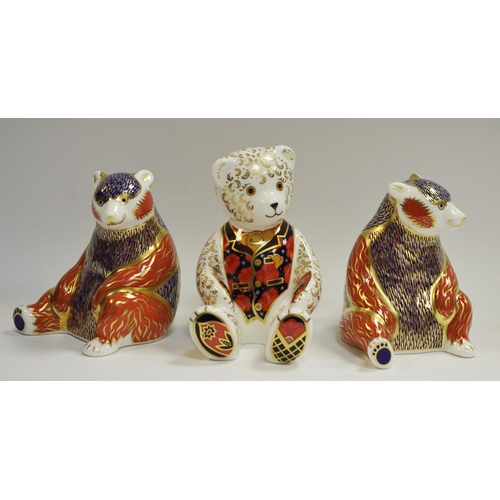 29 - A pair of Royal Crown Derby Honey bear paperweights, boxed; an exclusive Collector's Guild Debonair ...