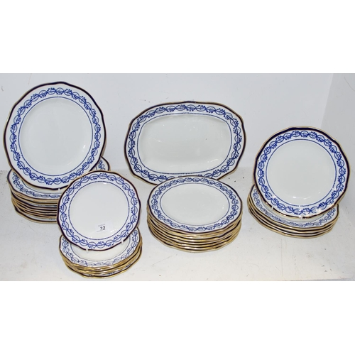 32 - A Royal Crown Derby blue and white border dinner setting...