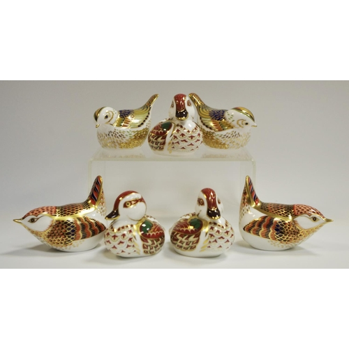 34 - A couple of Royal Crown Derby paperweights Fire Crest; another couple similar; three Bakewell Duckli...