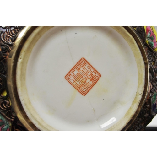 36 - An unusual, large Chinese porcelain opium water bowl in the form of a pumpkin, metal bound polychrom...