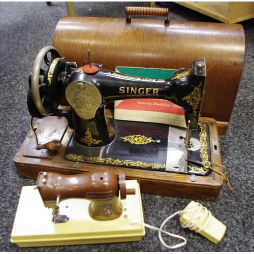 42 - An early 20th century Singer sewing machine (with key); Holly Hobble, Chad Valley sewing machine (2)...