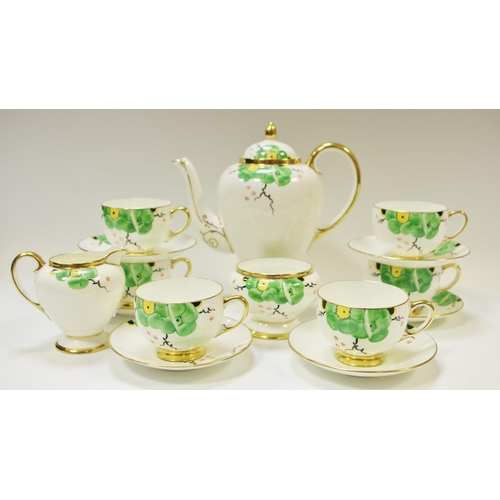 47 - A Paragon Art Deco hand painted coffee set for six comprising coffee pot, creamer, sucrier, six coff...