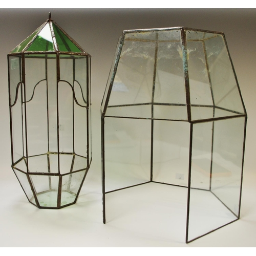 52 - An early 20th century clear and emerald stained glass ceiling terrarium; another larger cloche (2)...