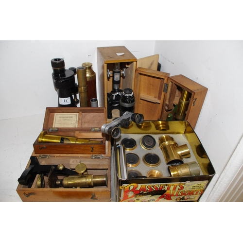 31 - Scientific Instruments - a Victorian mahogany cased students microscope; another; other microscopes;...