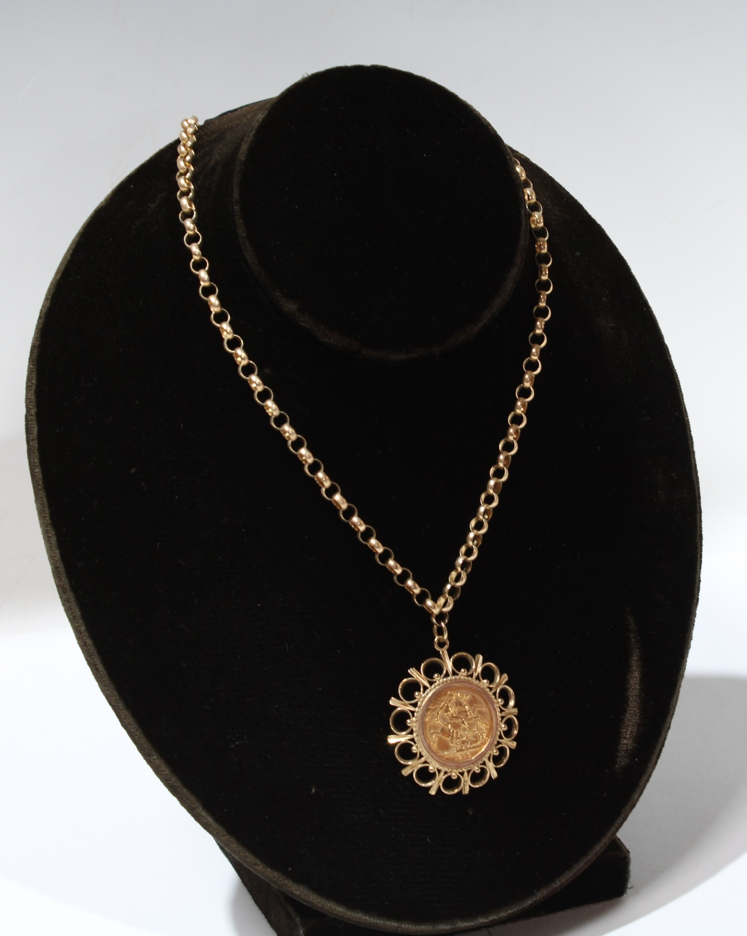 An Elizabeth II gold sovereign 1976, mounted in 9ct gold as a pendant...