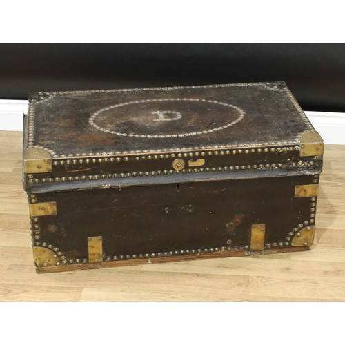 An 18th century brass bound leather travelling trunk, hinged cover, studded borders, swan neck carrying handles, paper label to interior, c.1770