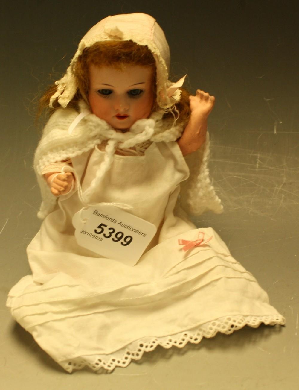 Armand Marseille - a 390 bisque head miniature baby doll, sleeping blue...