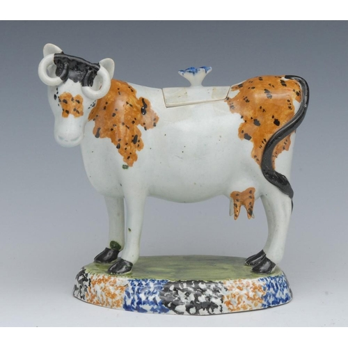 16 - A 19th century Staffordshire Pearlware cow creamer, standing four square, tan patch markings with bl...