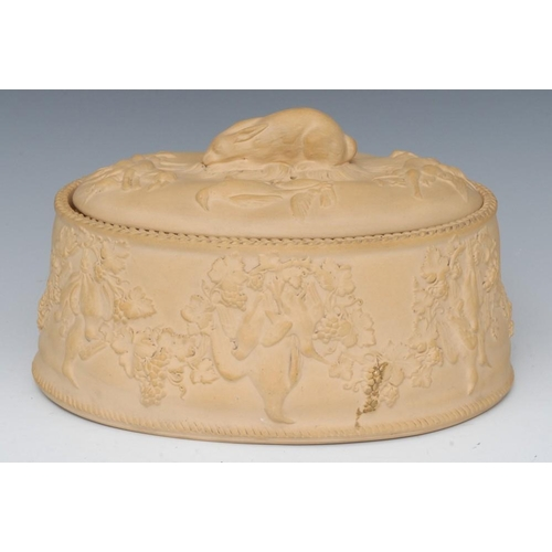 18 - A 19th century Wedgwood Cane ware game pie dish, liner and cover, the cover with hare, the sides dec...