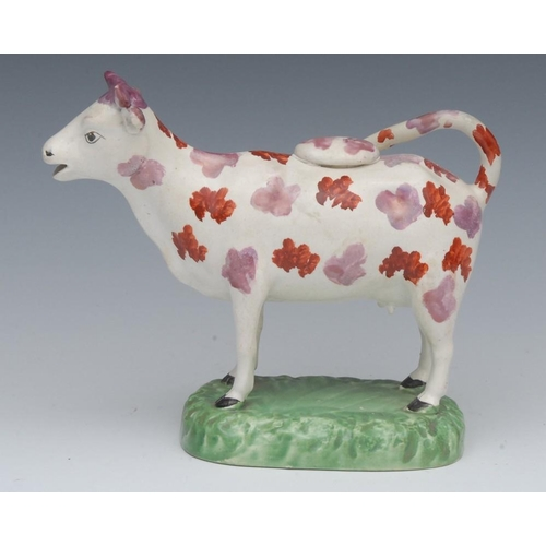 2 - A 19th century Sunderland lustre cow creamer and cover, with pink and lustre markings, oval base, 14...