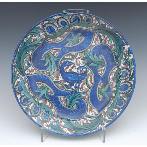 22 - A John Pearson charger, painted with stylised birds and leafy scrolls, on a Sunderland lustre leafy ...