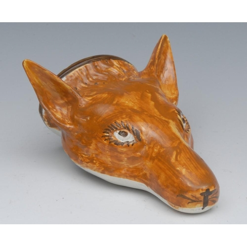 37 - A Staffordshire Pearlware fox-mask stirrup-cup, painted in ochre shades, 13cm long, first quarter 19...