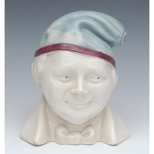 39 - A Stoneware novelty warming jug, as a gentleman wearing a night cap, 19cm high, c.1890...