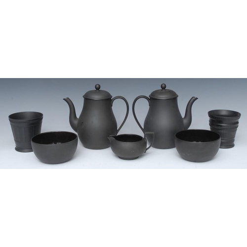 40 - A Wedgwood basalt engine turned flared vase, 10cm high, impressed mark; two baluster coffee pots, mi...