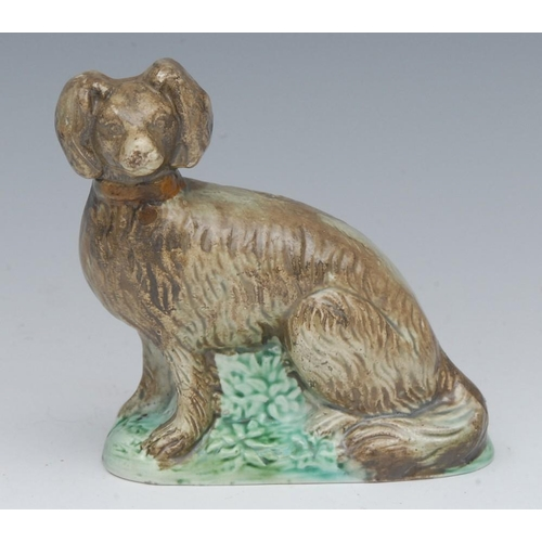 46 - An early 19th century model, of a dog, green moulded base, 9.5cm high, c.1820...