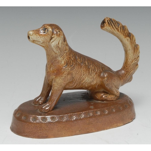 48 - An unusual and rare 19th century Brampton salt glazed stoneware novelty water squirter, as a seated ...