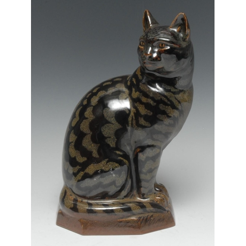 49 - Charles Vyse (1882-1971) - a stoneware model of a seated tabby cat, Tamoku glaze, canted rectangular...