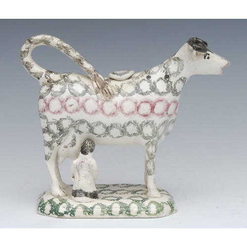 5 - A 19th century cow creamer and cover, standing four square, with milkmaid, sponged in lines with rou...