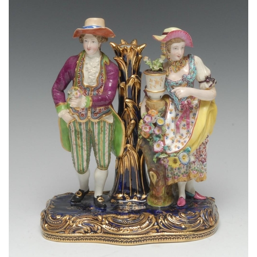 57 - A rare Minton figural candlestick or taper holder, modelled with a gentleman and his lady enjoying f...