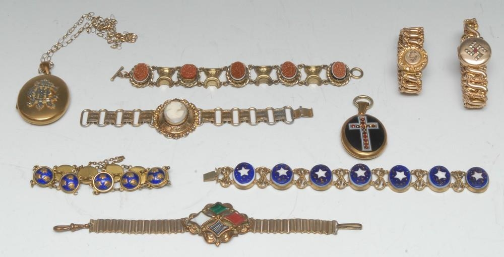 A Victorian gilt metal bracelet, set with five oval gold stone panels...