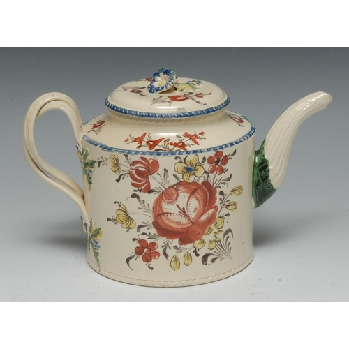 1 - An English creamware teapot and cover, painted with stylised roses and foliage, entwined loop handle...