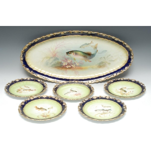12 - A George Jones Crescent China fish service, painted by W. Birbeck, signed, with salmon amidst weeds ...