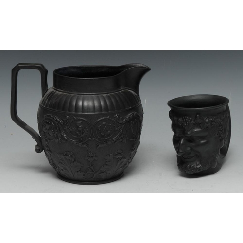 18 - A Wedgwood black basalt Bacchus cup, with vine chaplet, 10cm high, a similar black basalt jug, mould...