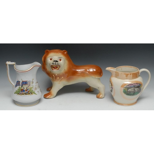22 - A Victorian Staffordshire lion, standing to the right, glass eyes, coloured in brown, 27cm high, c.1...
