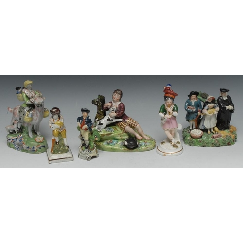 24 - A Staffordshire Tithe Pig Group, modelled with parson and a couple, he wearing a broad brimmed hat a...