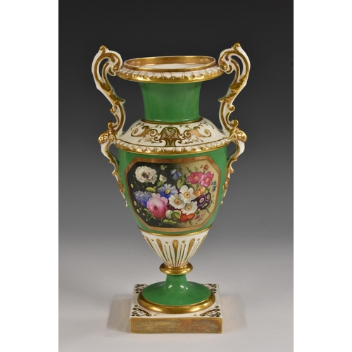26 - An English porcelain pedestal two handled vase, well painted with flowers in a gilt octagonal panel ...