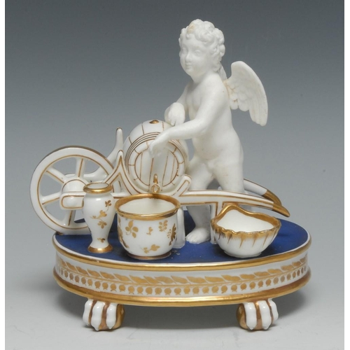 27 - An English porcelain figural inkstand, modelled with a biscuit cherub and a glazed wheel barrow with...