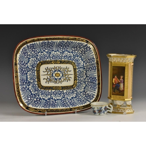 28 - An 18th century miniature toy teacup, decorated with overglaze enamels and underglaze blue, picked o...